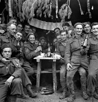 Canadian soldiers enjoying a few drinks on Christmas Day at the front, Ortona, Italy, 25 December 1943. Library and Archives Canada PA-163936