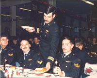 Men's Annual Christmas Dinner, 8 Dec 1987 ( L to R) Cpl McCauley J.T. Terminal Equipment Technician 222, Cpl Guerin J.R. Radio Operator 211, MCpl Fisher P.D. Lineman 052. PAC87-677-8