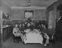 Christmas dinner including Captain Agar Adamson (2nd from left) of Princess Patricia's Canadian Light Infantry. Agar Stewart Allan Masterton Adamson / Library and Archives Canada / PA-139711